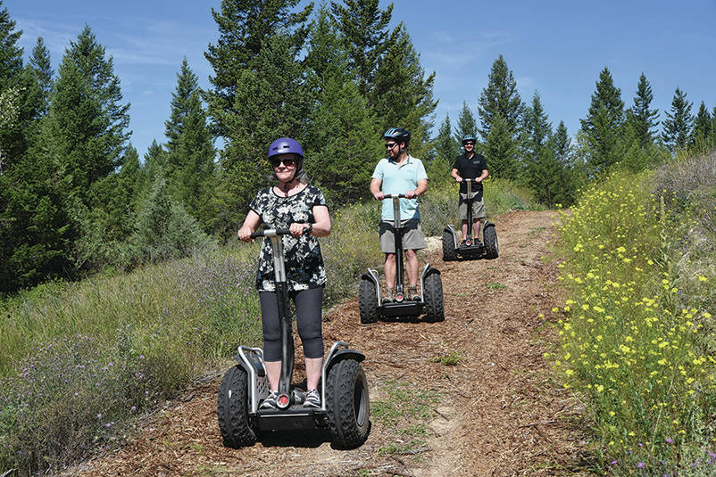 Segways scooting through the woods