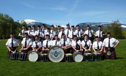 Local bagpiper and band blow their way to victory