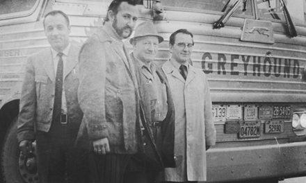 Four men and a Greyhound bus