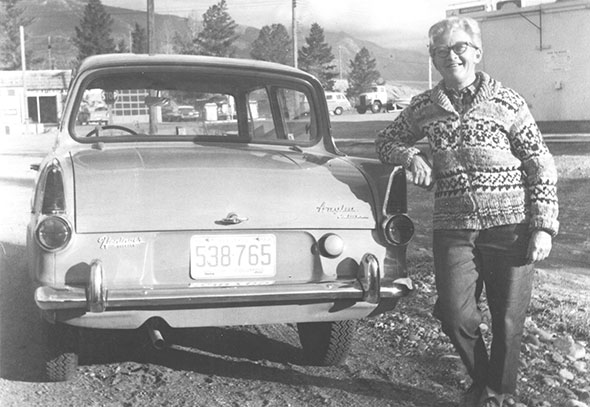 Lady leaning on a car, 1968