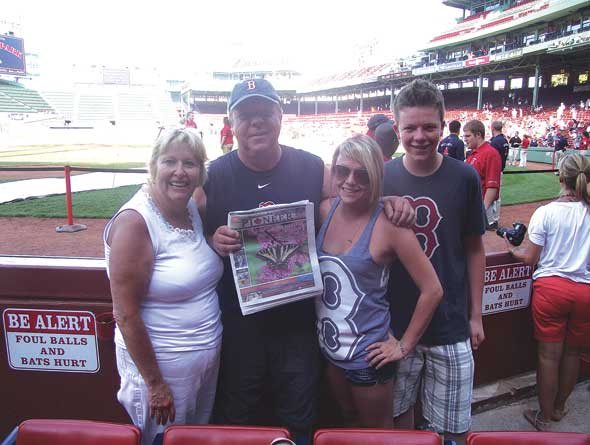 Edgewater residents Cyndie, Duane, Madison and Taylor McOuat take in a game at Fenway Park in Boston with their favourite newspaper.