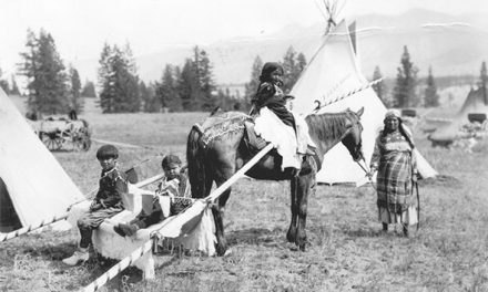 Woman with three children, 1922