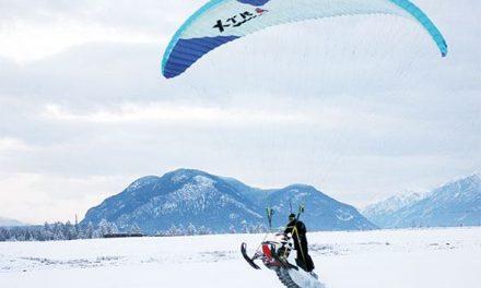Paragliding snowmobiler combines hobbies