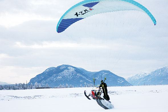 Paragliding snowmobiler combines hobbies