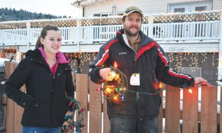 Family Lights up Holiday