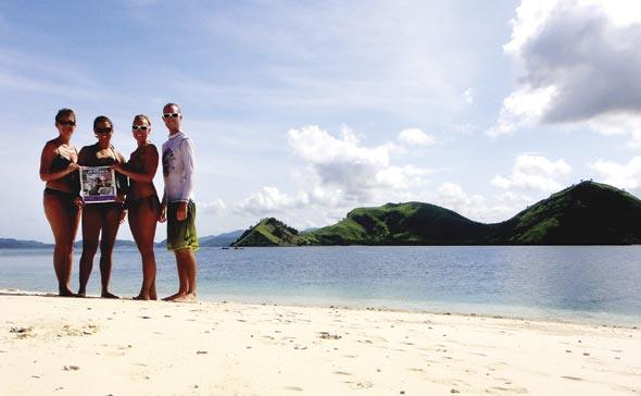 Ukass family enjoy the beach at Sabolo Island, Indonesia.