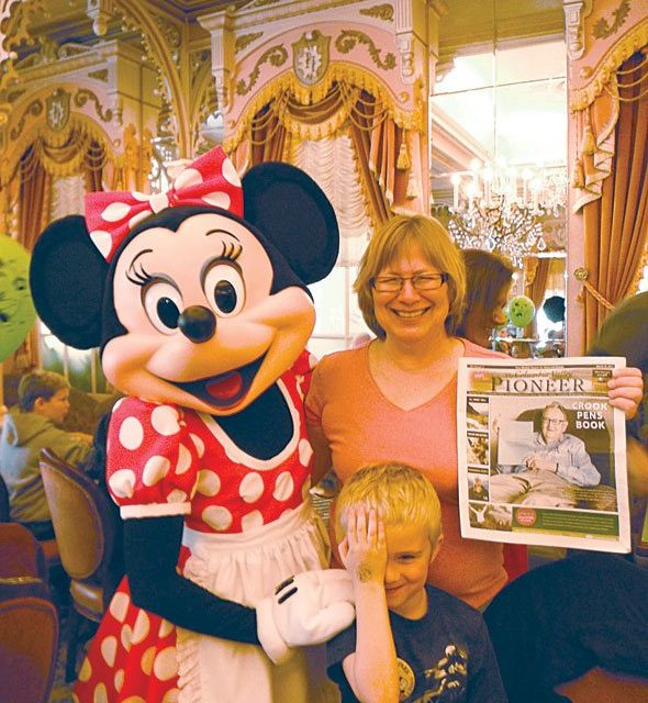 Virginia Walker, Hollis Babich and Minnie Mouse in Disneyland, California.