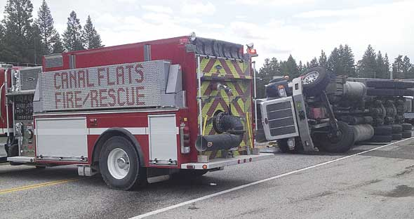 Semi-truck flip shuts down highway